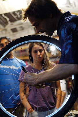 Phoenix teaching Time's Up! Bike Repair Class- photo by Serge Cashman for Time's Up!