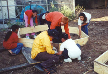 Building raised beds for a new community garden.